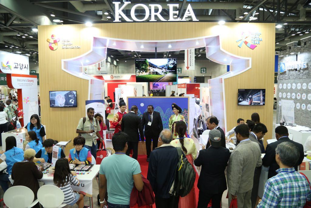Public relations officials and participants gathered in the Korea PR booth